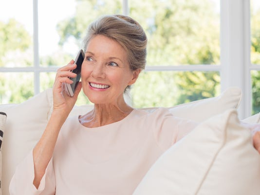 Older woman talking on phone