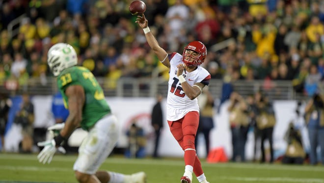 Dec 5, 2014; Santa Clara, Calif.; Arizona Wildcats quarterback Anu Solomon throws a pass against the Oregon Ducks in the Pac-12 Championship at Levi's Stadium.
