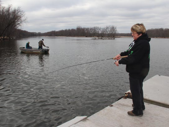 Nancy Roth of Manawa, Wis. fishes from the dock on