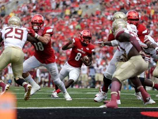 Louisville's Lamar Jackson looks to get in to the endzone