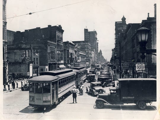 A traffic jam backed up streetcars in 1933 at Sixth