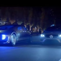 A Mercedes-Benz ad about self-driving capability includes both the F015 concept car, left, and the E-Class sedan