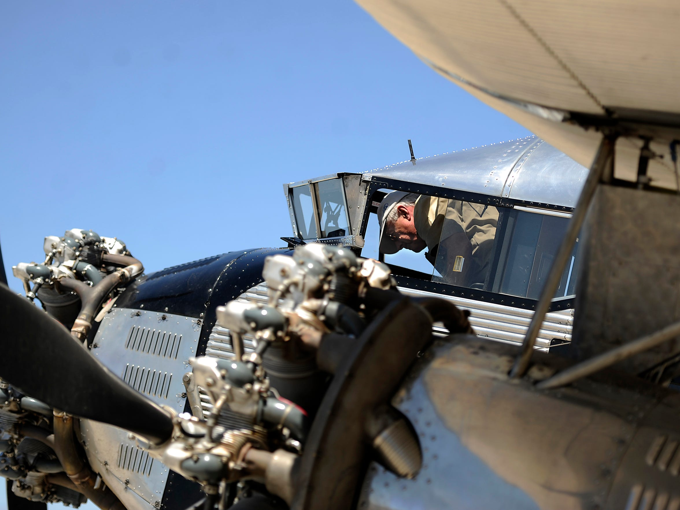 Pilot Bill Sleeper climbs into the cockpit of a 1928 Ford Tri-Motor airplane on Thursday, May 4, 2017, at the Abilene Regional Airport.