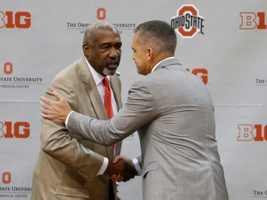 Ohio State athletic director Gene Smith, left, shakes hands with Chris Holtmann after naming Holtmann the new men's head basketball coach at Ohio State, Monday, June 12, 2017, in Columbus, Ohio. (AP Photo/Jay LaPrete)
