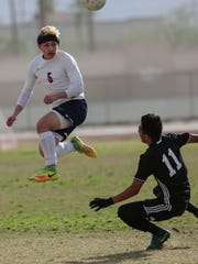 La Quinta's Steven Poole heads the ball against Chaffey in the first half on Friday, February 17, 2017 in La Quinta.
