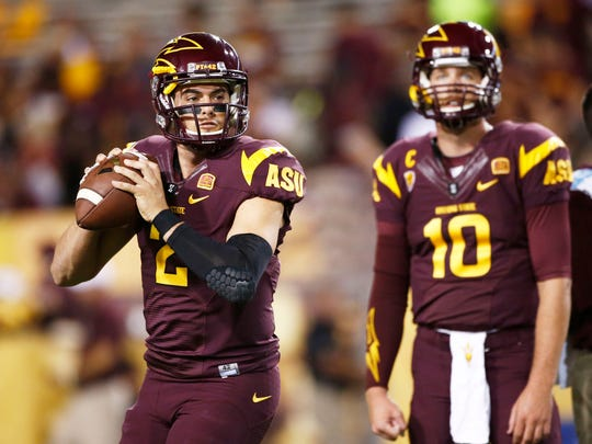 Arizona State quarterbacks Mike Bercovici (2) and Taylor Kelly (10) warm-up before the game against Stanford on Saturday, Oct. 18, 2014 at Sun Devil Stadium in Tempe.