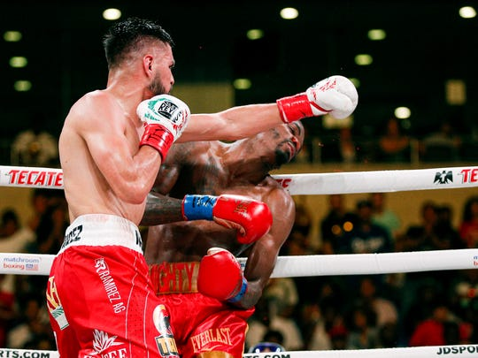 Jose Ramirez lands a punch against Maurice Hooker in the sixth round of last Saturday's bout in Arlington, Texas.