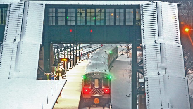 A Manhattan-bound Metro-North train leaves Tarrytown Monday. Overnight snow turning to freezing rain made for treacherous conditions for the morning commute. Metro-North remained on a normal weekday schedule.