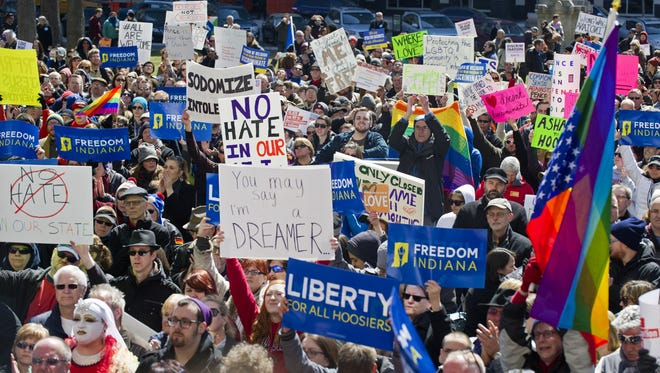 Opponents of an Indiana religious objections law rally March 28, 2015, outside the Statehouse in Indianapolis.