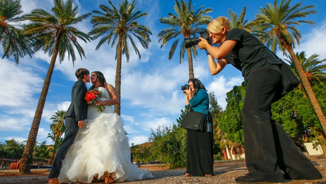 Groom Krista Castillo and bride Ellie Sauter are photographed on their wedding day.