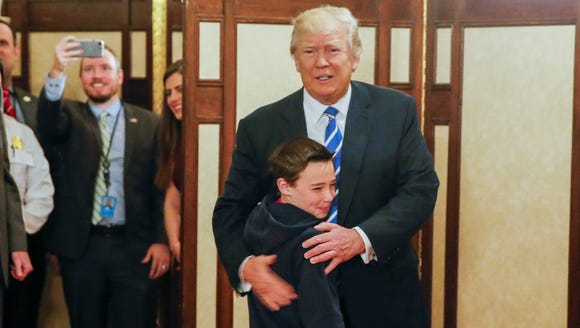 President Trump greets Jack Cornish, 10, of Birmingham,