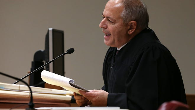 Judge James Piampiano, begins to read the law behind the trial order of dismissal.