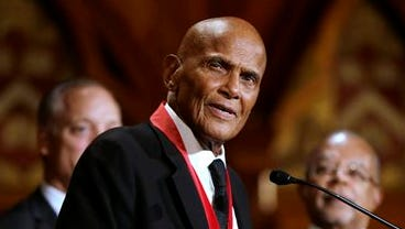 Artist and activist Harry Belafonte addresses an audience after accepting the W.E.B. Du Bois medal during ceremonies Tuesday on the campus of Harvard University, in Cambridge, Mass. The DuBois Medal is Harvard's highest honor in the field of African and African American Studies.