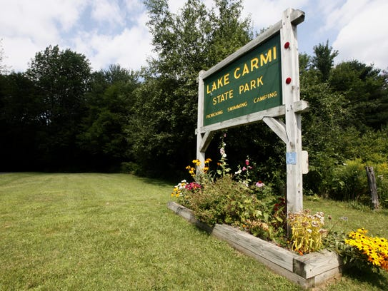 A sign marks the entrance to Lake Carmi State Park