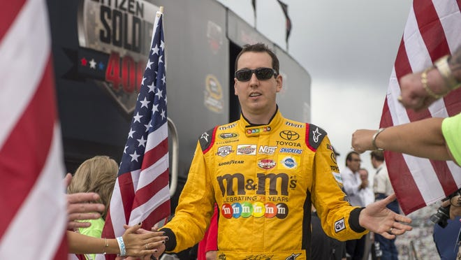 Sprint Cup Series driver Kyle Busch (18) is introduced before the start of the Citizen Soldier 400 at Dover International Speedway