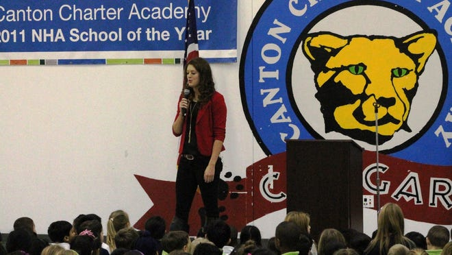Olympic medalist Allison Schmitt came home Monday to talk to students gathered at Canton Charter Academy, where Schmitt was a member of the first graduating eighth-grade class.