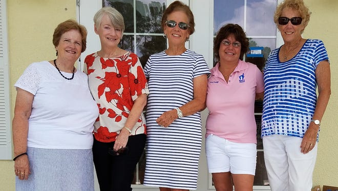 NANA'S HOUSE receives brand new shoes from New Neighbors of South Brevard Beaches. Pictured, from left, are Kelly Quinby, Randi Spice, Adrianne LaJoie, Nana's House Director Kim Frodge, and June Stoff.