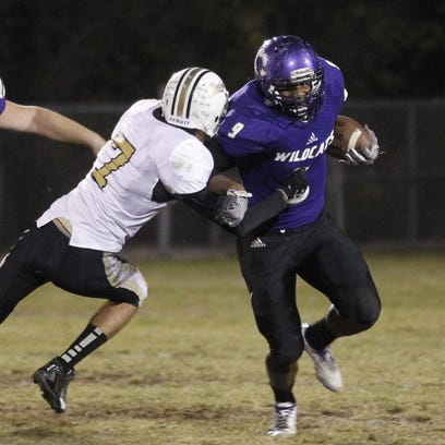 Clarksville High's Brevon Johnson pulls away from a Springfield player during a game last season. The Wildcats face Kenwood Friday night.
