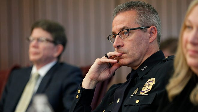 IMPD Chief Bryan Roach listens during the hearing. Two Indianapolis police officers who last summer fatally shot unarmed black motorist Aaron Bailey appeared before the Civilian Police Merit Board on Tuesday, May 8, 2018.