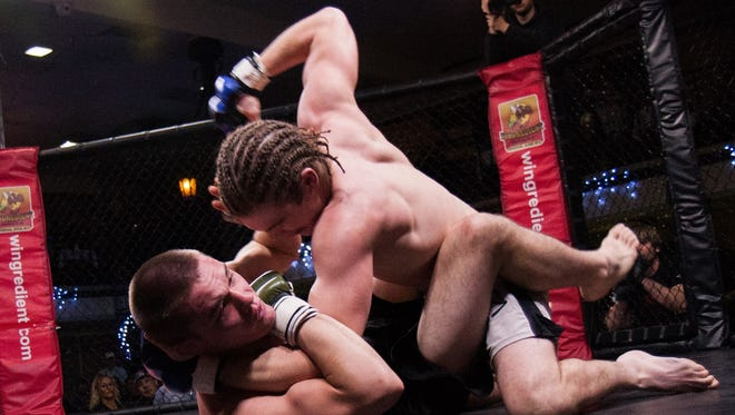 Tommy McMillen of Great Falls, right, is making his professional MMA debut Saturday night at Fusion Fight League's Rising Stars 2 fight card at Pacific Steel and Recycling Arena..