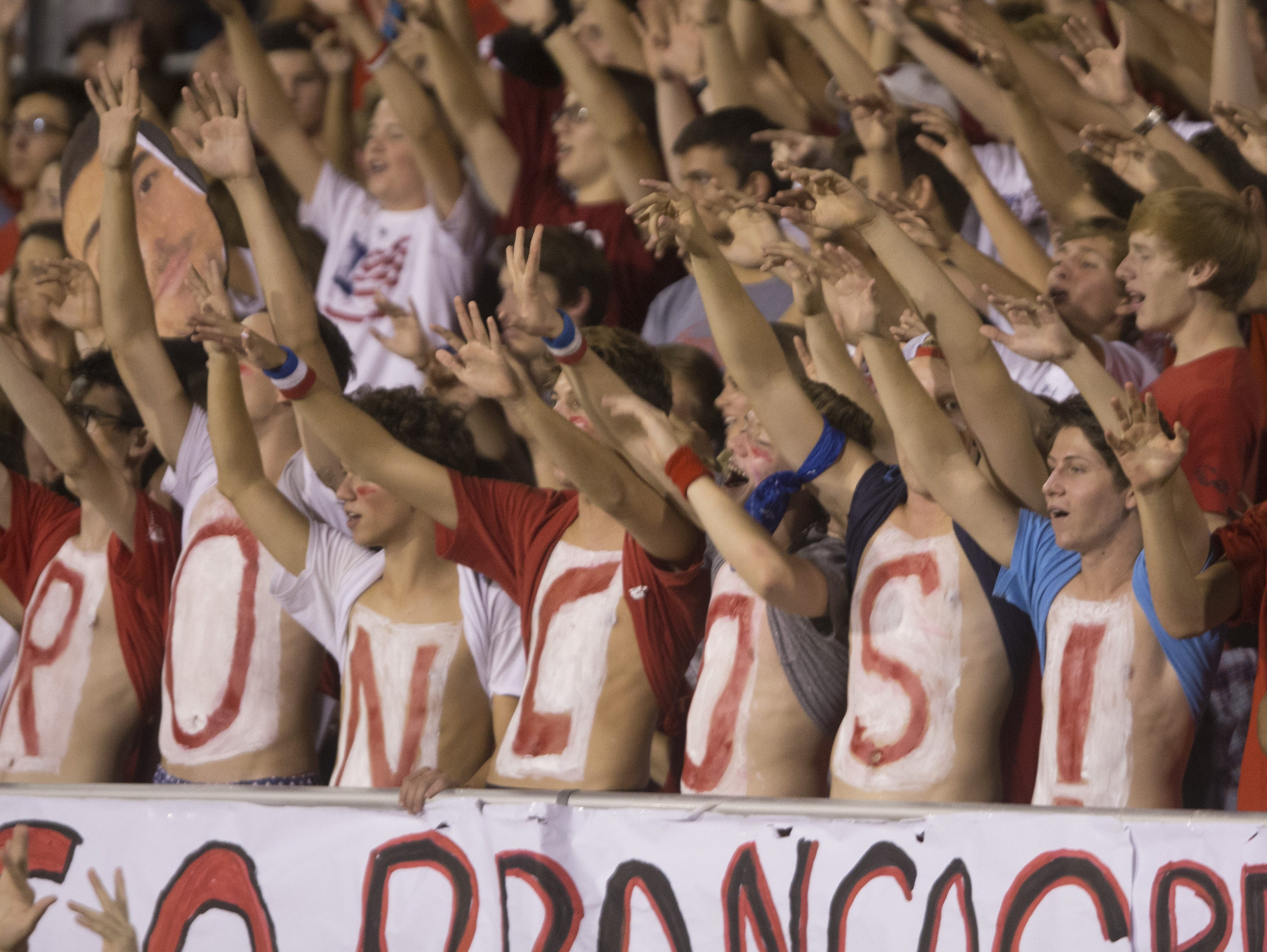 Phoenix Brophy Prep fans cheer on their team as they kickoff against Phoenix Pinnacle on Sept. 18.