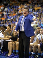 MTSU's head coach Rick Insell instructs his team from the sidelines during the MTSU vs Tennessee women's basketball game Friday at Murphy Center, on Nov. 8, 2013.