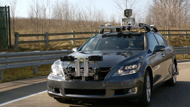 A Lexus LS sedan is testing a LiDar-based navigation system at Toyota's Tech Center in Saline. LiDAR, an acronym of Light Detection and Ranging, is packaged in a series of rotating devices mounted on the vehicle's roof.