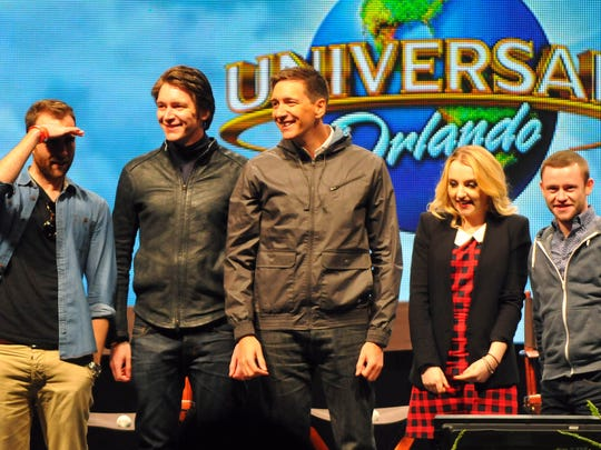 """From left: actors Matthew Lewis, James and Oliver Phelps, Evanna Lynch and Devon Murray pose for Universal Orlando patrons after a Q&A session. Universal Orlando hosted """"A Celebration of Harry Potter,"""" an event featuring items from the film franchise and news about the latest """"Harry Potter"""" expansion at Universal Orlando."""