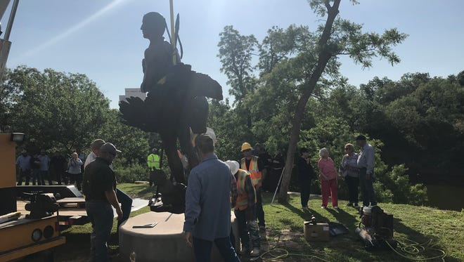 "A bronze sculpture of a Jumano brave is placed along the Concho River in downtown San Angelo on Friday, May 18. The work, by sculptor Vic Payne commemorates Sor Maria de Agreda, known as the ""Lady in Blue"" who is believed to have appeared miraculously to the natives of this area in the 1500s, instructing them to seek baptism."