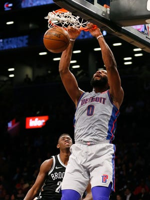Detroit Pistons center Andre Drummond (0) dunks the ball against Brooklyn Nets guard Caris LeVert (22) during first half at Barclays Center.