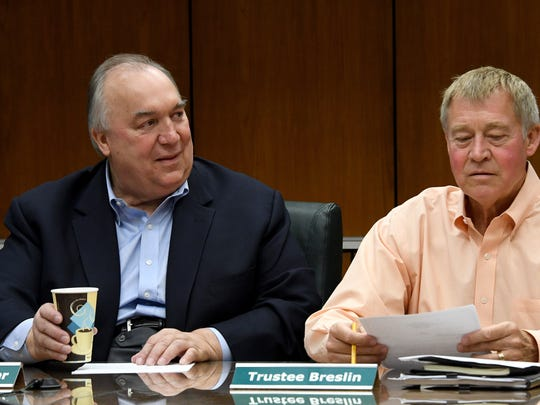 MSU interim President John Engler starts the meeting seated next to Trustee Brian Breslin as the MSU board of Trustees votes to approve Bill Beekman as the new athletic director.