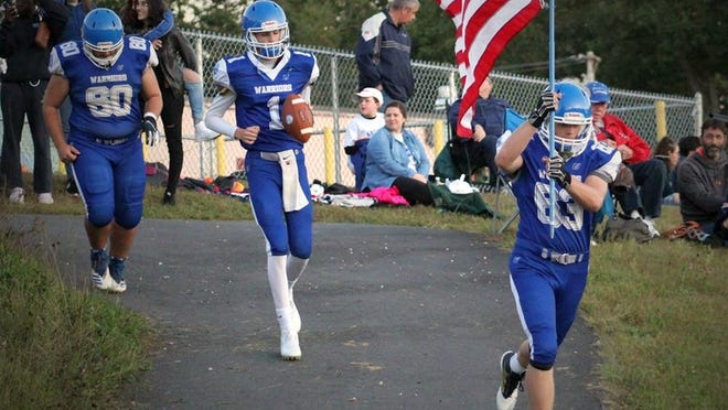 Narragansett Regional senior Alex Stellato carried the American flag onto Arthur L. Stuart Memorial Field ahead of the Warriors' home-opening football game against Southbridge last fall. A four-year member of the 'Gansett football team, Stellato also competed for the Warriors' indoor track team as a freshman and the outdoor track team for three seasons.