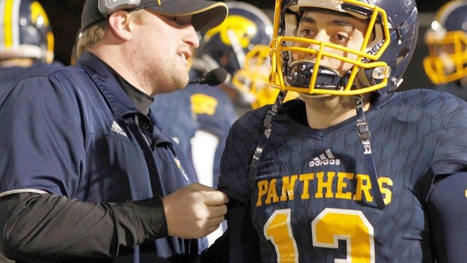 Quabbin senior Sam Coppolino stands next to head coach Dave Buchanan on the Panthers sidelines. Coppolino, who also ran track at Quabbin, will begin studying Physical Therapy at Springfield College in the fall.
