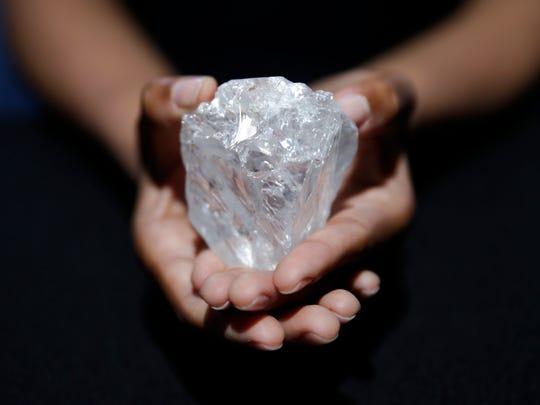A model displays the Lesedi La Rona diamond.