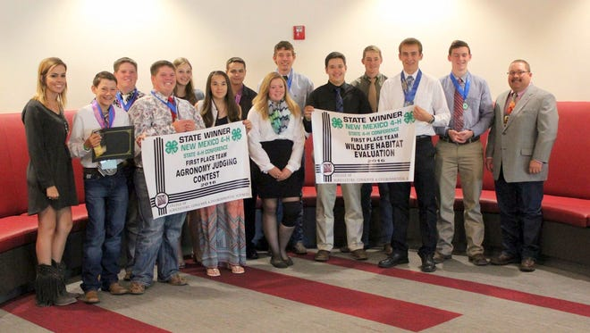 Luna County senior 4-H members stand with their first-place banners in Agromony and Wildlife Habitat Evaluation.
