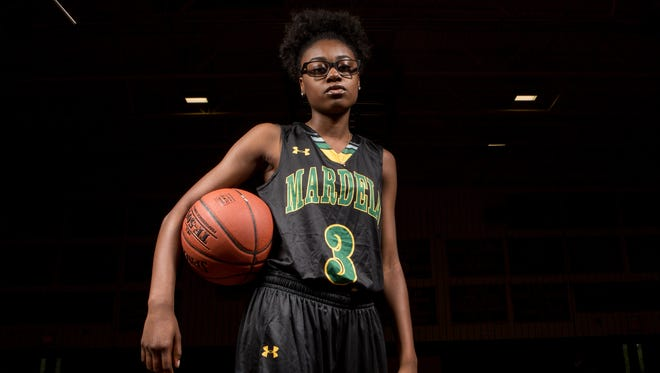 Mardela High School junior guard Kayla Cook poses for a photo wearing her Under Armour basketball uniform on Wednesday, June 15, 2016.