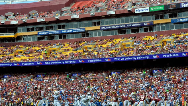 Spectators watch the first half of an NFL football game between the Washington Redskins and the Indianapolis Colts, Sunday, Sept. 16, 2018, at FedEx Field in Landover, Md. The half-century home sellout streak is over for the Washington Redskins. The announced attendance of 57,013 for Washington's 21-9 loss to the Indianapolis Colts on Sunday was about 25,000 short of the 82,000 capacity listed in the team's 2018 media guide.  (AP Photo/Mark Tenally)