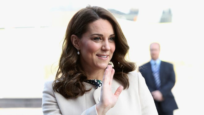 Duchess Kate waves to admirers.