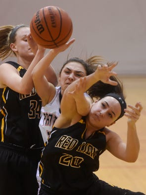 Central York's Sarah Sepic, center, is sandwiched between