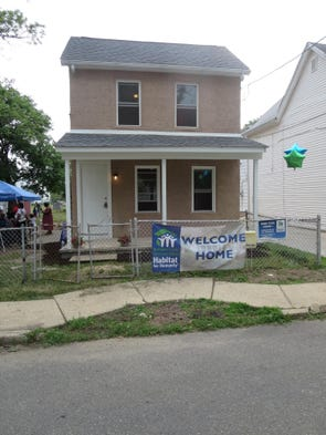 Anniemac employees help build house for Help building a house