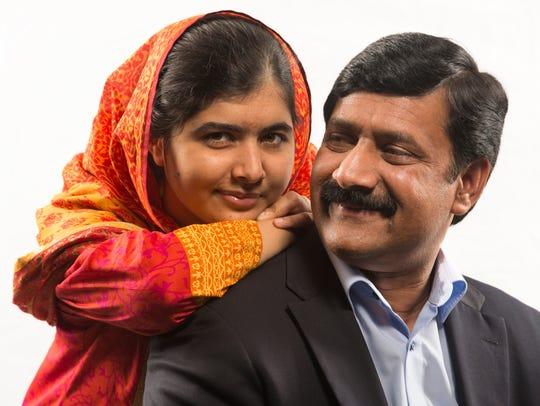 Malala Yousafzai and her father, Zia.