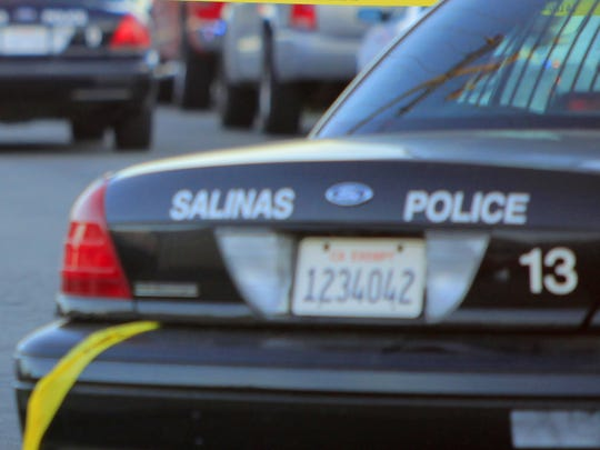 A Salinas police patrol car is parked at a crime scene