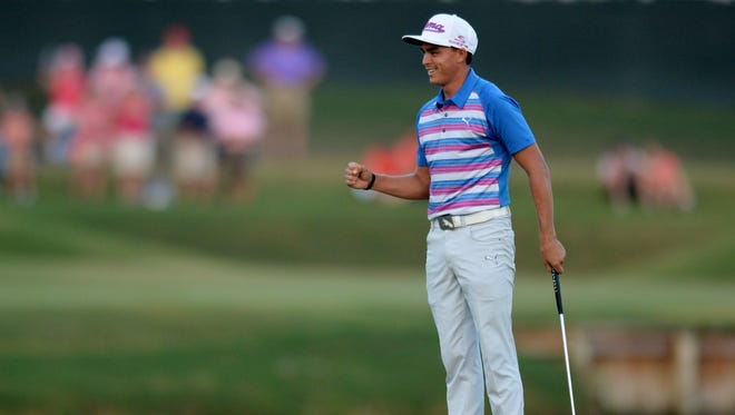Rickie Fowler celebrates after making a birdie putt on the 17th green (fourth playoff hole) to win The Players Championship at TPC Sawgrass on May 10, 2015.