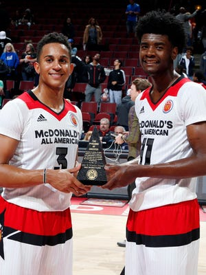 McDonald's All-American West guard Frank Jackson (3) and forward Josh Jackson (1) win the John Wooden Award as co MVP's after the McDonald's High School All-American Game at the United Center.