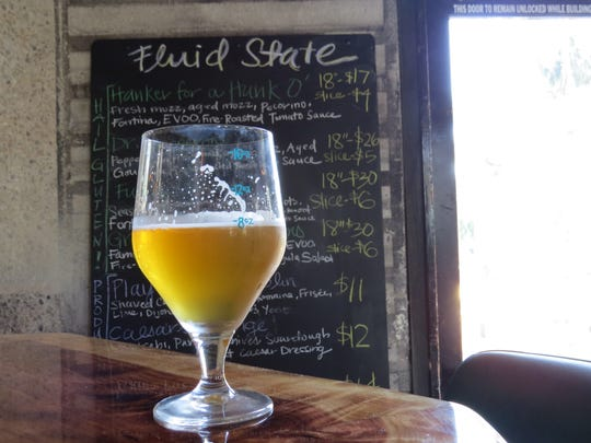 A glass of Chaos is a Friend of Mine, a sour ale from Beachwood Blendery in Long Beach, is seen at Fluid State Beer Garden in downtown Ventura.