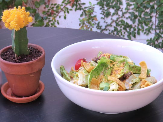 Tico Salad, a dish from the original The Nest restaurant in Ojai, is back: It features seasoned ground beef and beans tossed with greens, tomatoes, avocado and Fritos corn chips.
