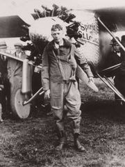 Charles Lindbergh poses with his plane, The Spirit