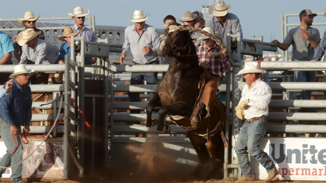 Drestyn Bell of Clarendon jumps out of the gate on a horse named Prairie Chicken during the Saddle Bronc Riding during the 78th Annual Will Rogers Range Riders Rodeo on Thursday.