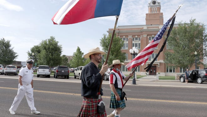 """Stephen """"Boats"""" Arthur (Navy Veteran), Eloy Heras (Navy Veteran) and James Smith (Army Veteran) decided to celebrate the Fourth of July by carrying the American and Texas State Flags while walking the normal route of the canceled Canyon parade Saturday morning."""