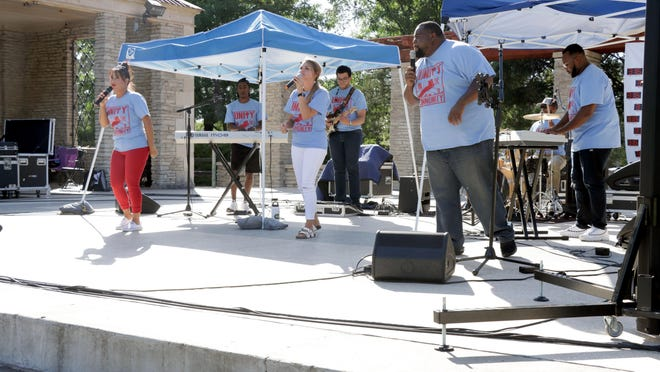 Worship United, made up of musicians from several area churches, takes the stage for the faith-based inaugural Unity in the Community concert at Sam Houston Park Friday evening. The free event invited everyone in the community to bring a lawn chair or blanket and enjoy live music, games for kids, barbecue, raffles and giveaways. For more photos from the evening, see Our Town on page A9.